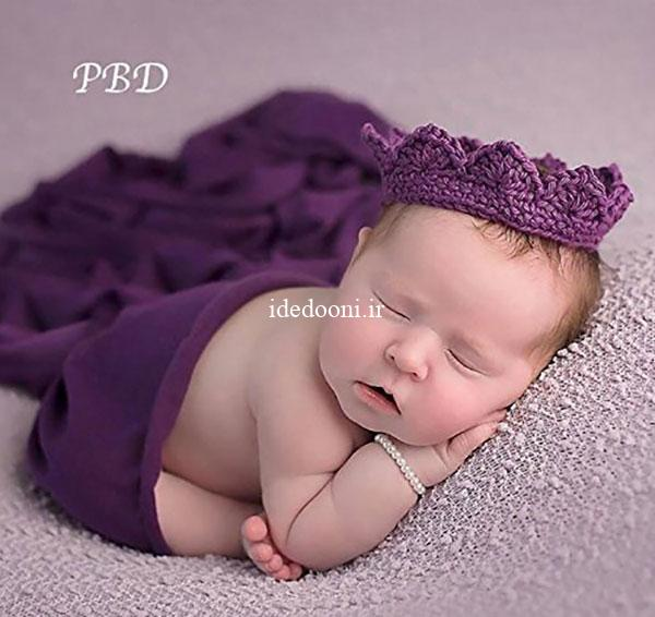 عکاسی نوزاد با تم رنگ بنفش